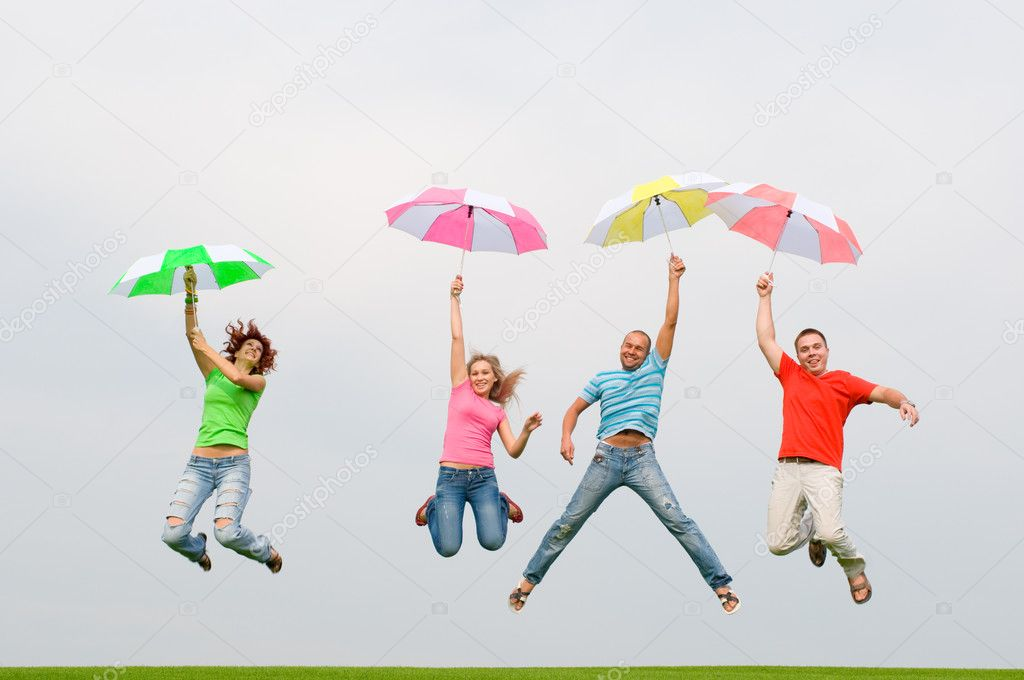 Young friends jumping with umbrellas — Stock Photo #1821389