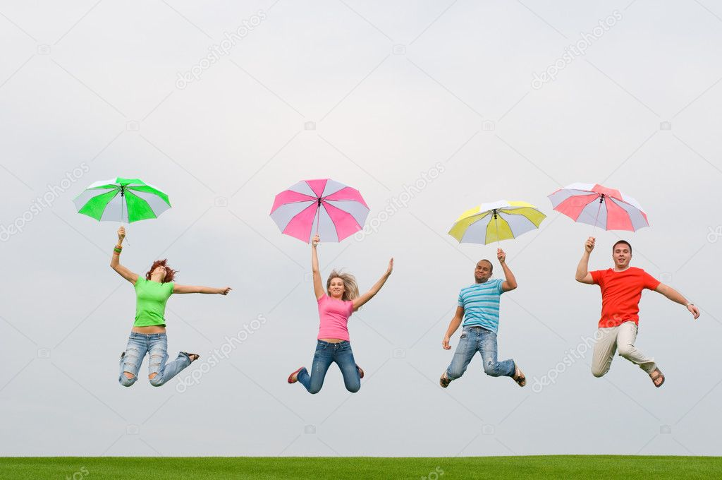 Young friends jumping with umbrellas — Stock Photo #1821453