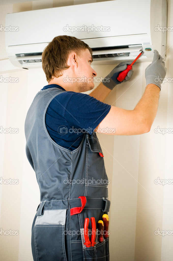 A man repair air conditioner  Stock Photo #1823408