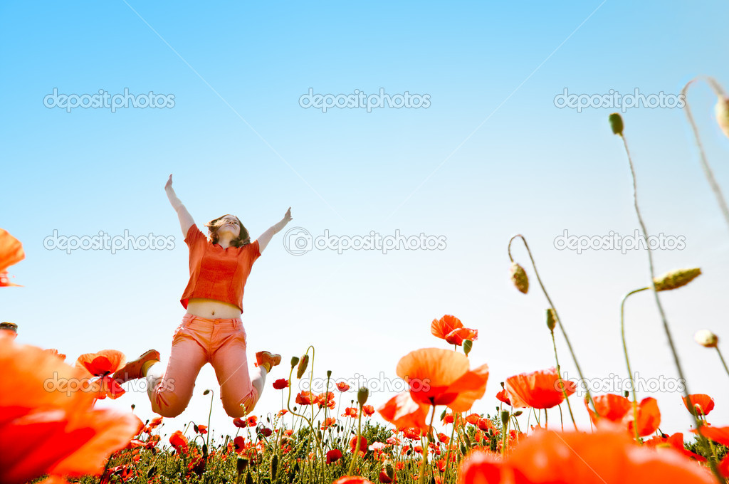 Girl jumping in red poppies field — Stock Photo #1828068