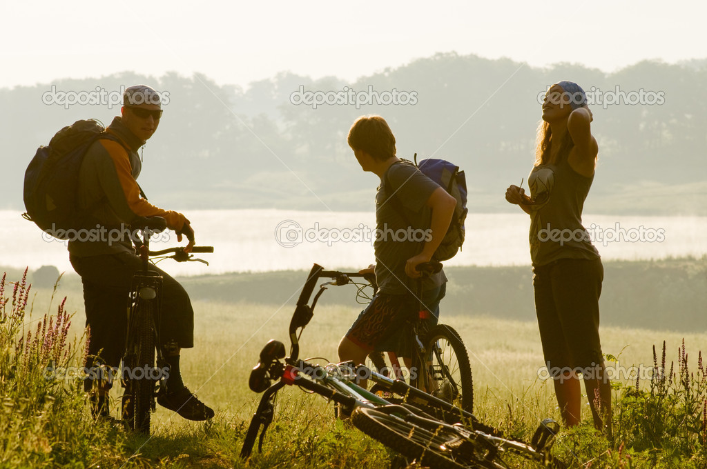 Mixed group of cyclists at sunset — Stock Photo #1828247