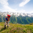 Trekking in mountains - Stock Photo