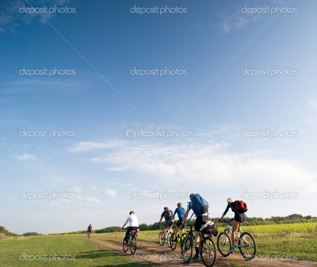 Mixed group of cyclists biking summer day — Stock Photo #2119090