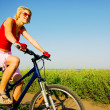 Stock Photo: Woman biking