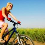 Woman biking — Stock Photo