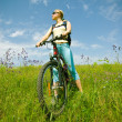 Stock Photo: Girl biking