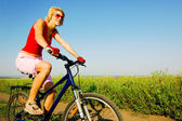 Woman biking — Stock Photo