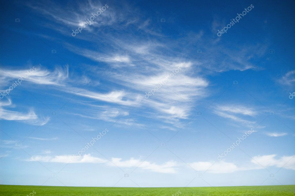Background of cloudy sky and grass — Stock Photo #2210705