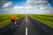 Man biking on road — Stock Photo