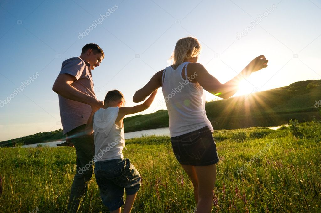 Happy family having fun outdoors — Stock Photo #2599292
