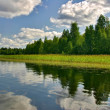 Cloudscape with reflection — Stock Photo