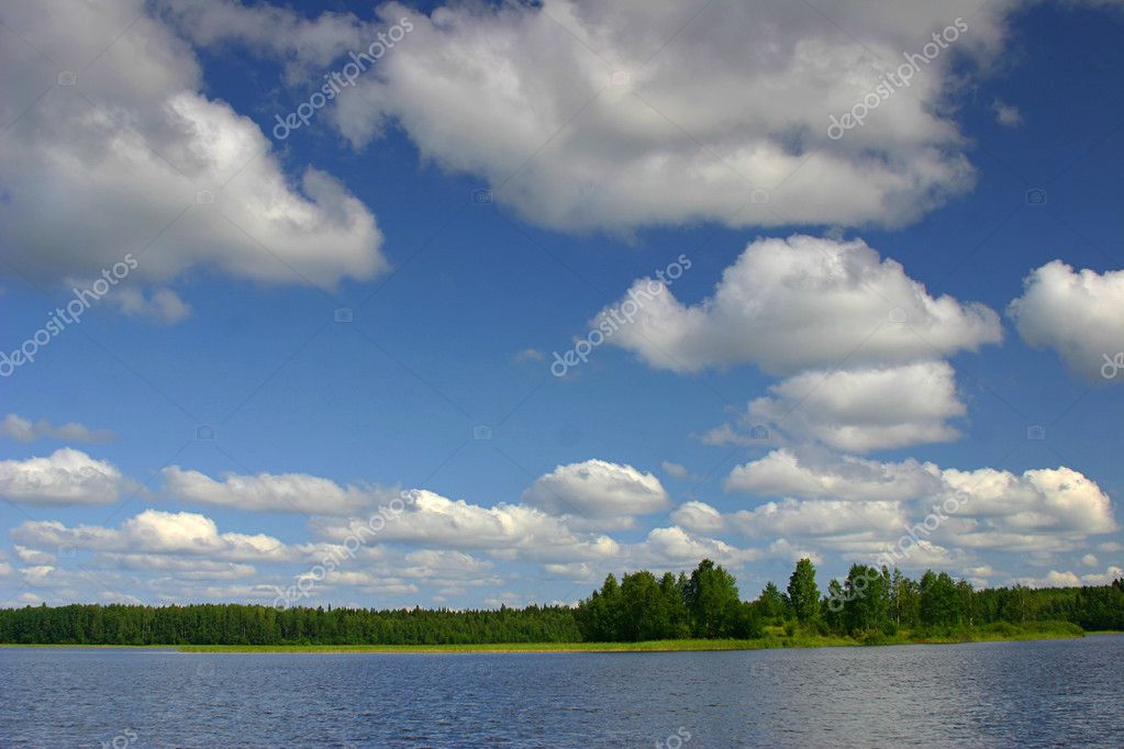 Landscape with blue sky, clouds, forest and like — Stock Photo #1704576