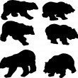 Six bear silhouettes — Stock Vector