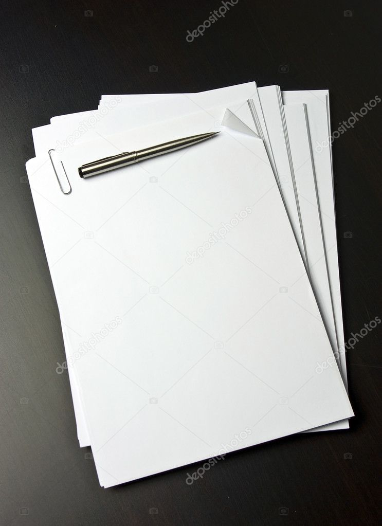 Blank pice of paper on black table — Stock Photo #1687474