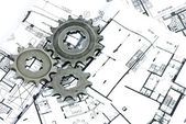 Gears and plans — Stock Photo