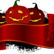 Pumpkin heads and banner - Stockvektor