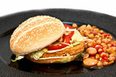 Chicken burger with bean sallad — Stock Photo