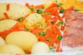 Potatoes an salmon meal — Stock Photo