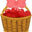 Colorful love hearts in wicker basket — Stock Vector