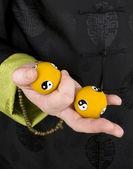 Music balls in hand — Stock Photo
