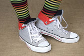 Striped socks and sneakers — Stock Photo