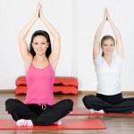Women doing yoga exercise — Stock Photo