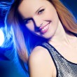 Stock Photo: Woman with disco ball over silver backg