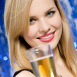 Woman with glass of champagne — Stock Photo #1682462