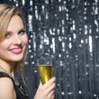 Smiling woman drinking champagne — Stock Photo
