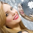 Woman with disco ball over silver backg — Foto Stock