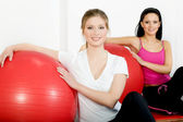 Women with fitness ball in the gym club — Stock Photo