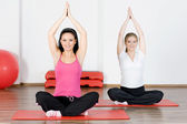 Women doing yoga exercise — Stock Photo