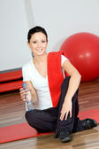 Woman in fitness club — Stock Photo