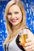 Young woman drinking champagne — Stock Photo