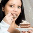 Woman with chocolade cake — Stock Photo #1712798