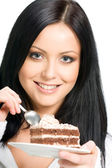 Smiling woman with chocolate cake — Stock Photo