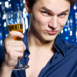 Man with glass of champagne — Stock Photo