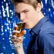 Handsome man drinking champagne — Stock Photo