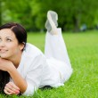 Smiling woman laying on grass — Stock Photo #1875670