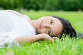 Sexy woman laying on grass — Stock Photo