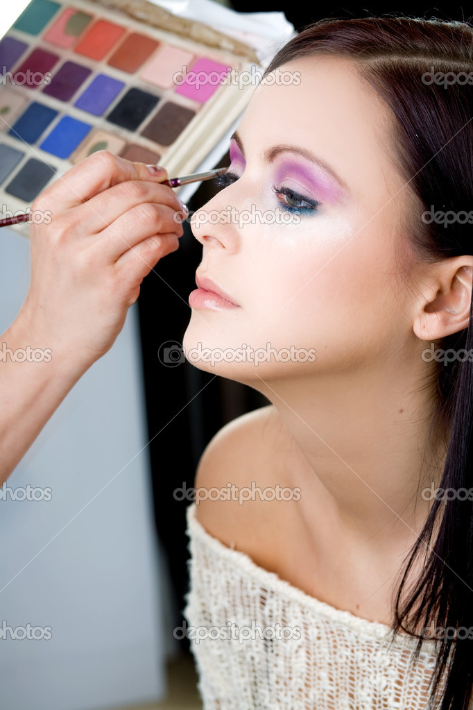 Woman putting on models eye make up  — Stock Photo #2069709