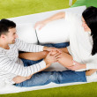 Young happy couple sitting on couch — Stock Photo #2126711
