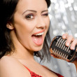 Portrait of singing woman - Stock Photo