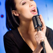 Beautiful woman singing — Stock Photo #2126730