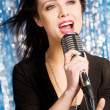 Beautiful woman singing — Stock Photo