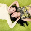 Happy couple laying on carpet — Stock Photo