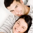 Young happy couple kissing - Stock Photo