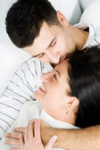 Young happy couple kissing — Stock Photo