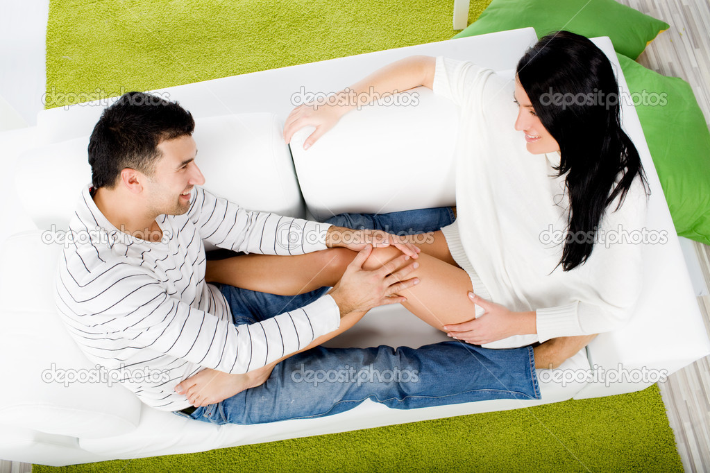 Young couple sitting on couch — Stock Photo #2126711