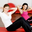 Stock Photo: Women doing fitness exercise